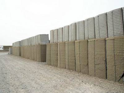 Several bastion barriers are piled up in the military base.
