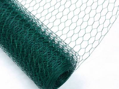 A roll of PVC coated chicken wire on the white background.