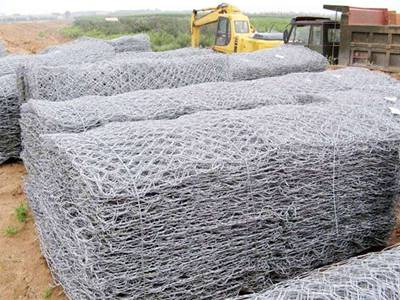 Several bundles of gabion boxes on the construction site.
