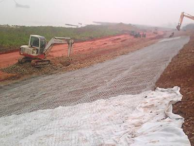 Two machine is filling the gabion mattress with stones.