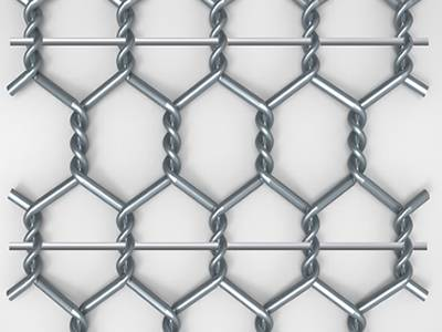 A piece of galvanized road mesh on the gray background.