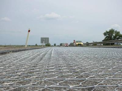 The road mesh is laying on the highway.