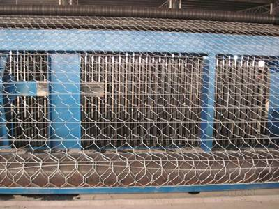 A machine is producing the road mesh.