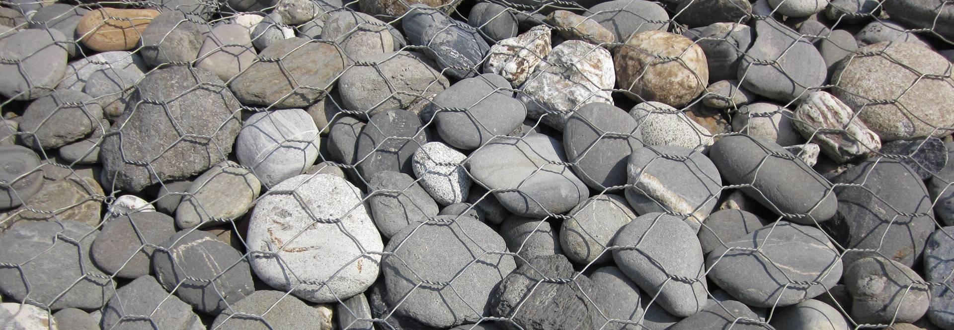The rocks are covered by rockfall netting.