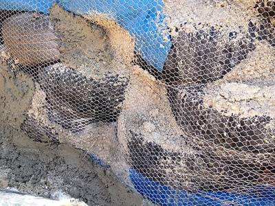 The foundation is wrapped in the stucco netting.