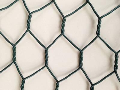 A piece of PVC coated woven gabion with double twist structure.