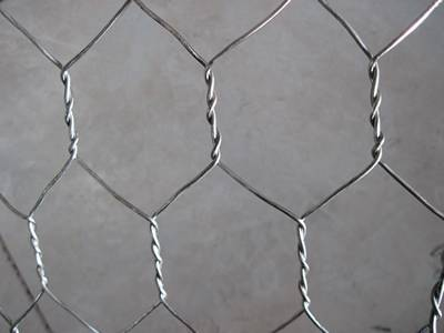 A piece of PVC coated woven gabion with triple twist structure.